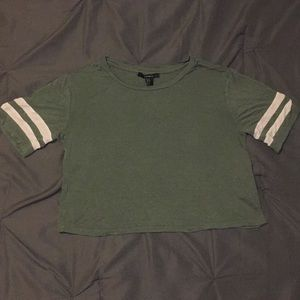 Green shirt with 2 white stripes on the side.